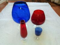 4 Various sized coloured glasses