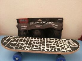 KIDS SKATEBOARD WITH SAFETY PAD KIT GOOD CONDITION