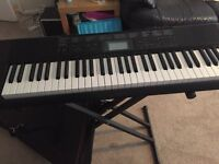 Mint Condition CASIO keyboard includes Fold down stand, carry case and power pack