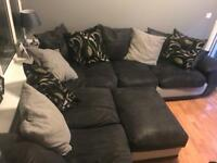 Black and Grey Corner Sofa and Puffy