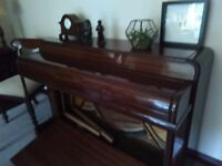 Mahogany low piano. Beautiful condition. No marks or scratches.