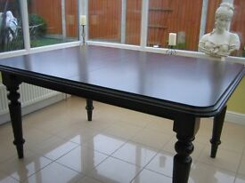 A large Mahogany Dinning Table seats 8 people when extended.