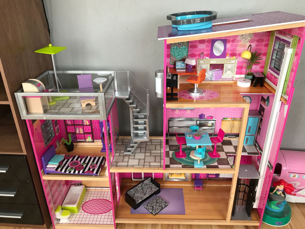 Barbie DollDolls House by Kidkraftin Orrell, Manchester - Selling my little girls dolls house. It is a kidkraft one and cost me £250 last year. Has a few marks as you can see from the pictures. Few of the accessories have marks too other than that in great condition. Very big dolls house and solid. Comes...