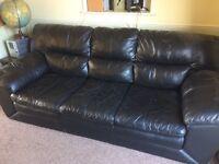 Black leather sofa, slightly worn, super comfy!