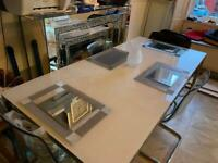 White glass table with 4 IKEA clear chairs
