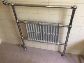 Towel rail and cast iron radiators