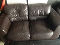 2 two seeter leather sofas,fairly good condition