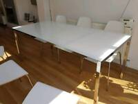 White & chrome glass dining table.