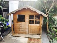 Children's wooden playhouse. In very good condition.