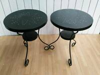 Two black metal garden tables