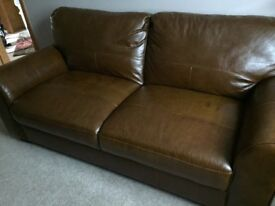 Brown leather sofa almost new selling as I'm down sizing