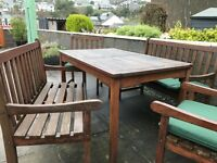Wooden Garden Table with 2 Matching Benches, 2 Chairs with Arms and Nearly New Green Seat Cushions
