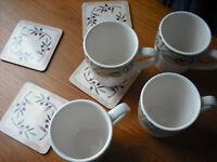 Brand New Set of 4 Mugs and Matching Coasters £10