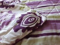 Matching reversable Doube Bed Set with curtains.Purple/ Green pattelrn on white back ground