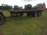 Farm Trailer, flat bed bail trailer.