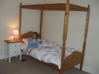 Pine four poster single bed with pink bed curtains - Rutherglen