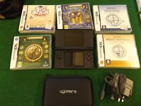 Nintendo DS in black with case, games and charger.