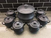 Le Creuset stoneware pot and smaller serving bowls
