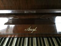 Much loved Amyl piano and stool for sale.