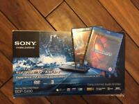 Blue ray player and 2 sealed Spider-Man films