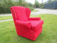 A Lovely Red Wingback Armchair