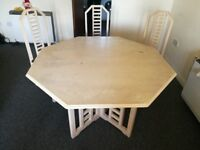 Big and expandable dining table with 3 matching chairs