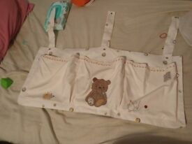 Bear nappy stacker for a cot