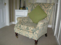 Parker knoll wing back chair.