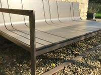 Designer garden sofa with cushions and protective cover