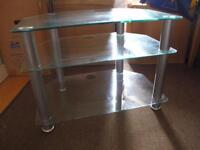 Glass and chrome frosted shelf and tv unit.