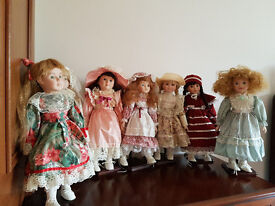 Classique Collection of Seven Porcelain Dolls Numbered and with stands with original boxes