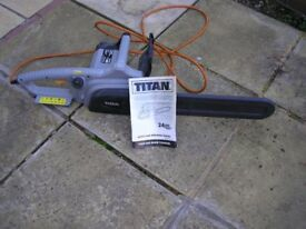 TITAN ELECTRIC CHAIN SAW, GOOD CONDITION ,HARDLY USED