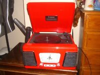 Red steepletone reproduction record player and radio