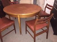 Solid wood round extending table and 4 chairs
