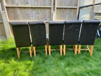 Set of 5 brown dining chairs, with high roll backs