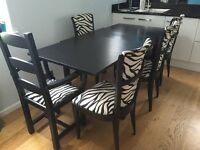 Habitat extendable black ash table and 6 chairs