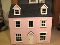 Three storey dolls house and some furniture