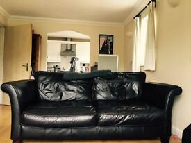 Large three seater real leather brown sofa & matching armchair