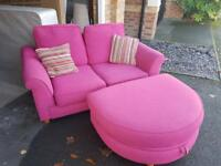 Pink sofa and poof