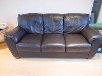 Matching pair of 3 seater dark brown leather sofas