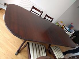 Extending wood table and 4 chairs