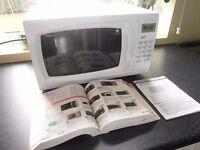 White digital Microwave 700 watts model EM717 current model