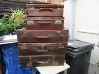 5 x suitcases 1940s various sizes 3 are leather, 2 are oilcloth.