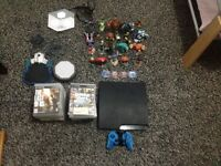 PS3 SLIM 320GB WITH 25 GAMES WITH SKYLANDERS GIANTS AND DISNEY INFINITE
