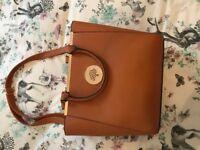 Tan handbag and matching purse