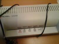 Laminator with 4 boxes of laminator sheets