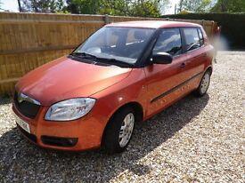 2009 Skoda Fabia 1 TDI 80 5 Door Hatchback. Tangerine Orange Pearlescent.