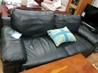 Black leather large 2 seater sofa