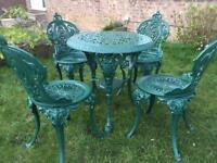 Cast iron table & Chairs ( new )