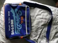 Genuine superdry bag.
